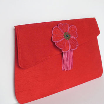 Red taffeta Clutch with an embroidered flower and a pink tassel
