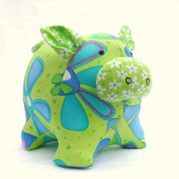 Blue, green, pink stuffed soft toy, mini Polly the pig.