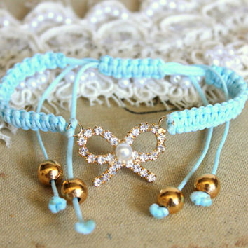 Friendship bracelet sky blue braided with real swarovski rhinestones .