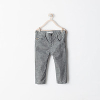 Skinny trousers with zip
