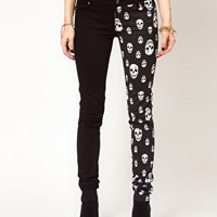 Tripp NYC Jeans With Split Leg Skull Print at asos.com