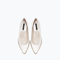 Zipped pointy ballet flat