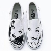 Graffiti painted canvas casual shoes legs -