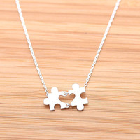 tiny HEART PUZZLE necklace, in silver