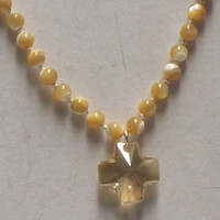 Knotted mother-of-pearl and crystal cross necklace