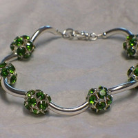 Rhinestone and tubes bracelet, Peridot green