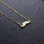 matt gold  mustache necklace --dainty and gold  tone