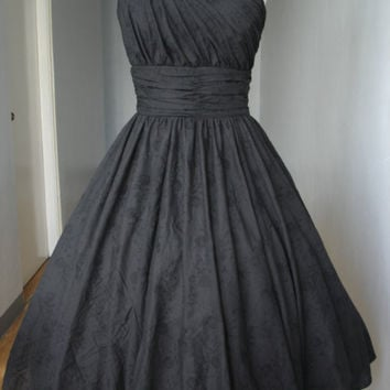 A beautiful 50s style cocktail dress shown made by elegance50s