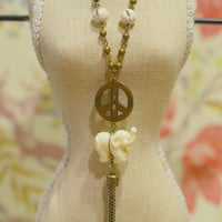 Long Boho Elephant & Peace Sign Necklace - Rosary-Style Necklace w/ White Howlite Beads, White Elephant, and Brass Peace Sign and Tassel