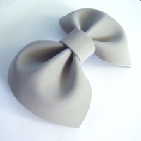 Gray hair bow on barrette clip.