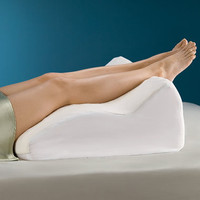 The Pain Relieving Contoured Leg Support - Hammacher Schlemmer