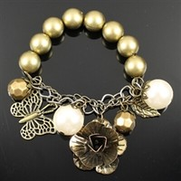 Gold and pearl beaded charm bracelet