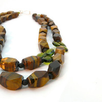 ENLIGHTEN. tigers eye necklace with two strands of honey gold stones with olivine swarovski crystal briolette accents