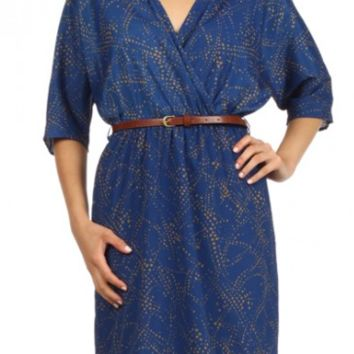 Spotted, wrapped dress with dolman sleeves and a belted waist.