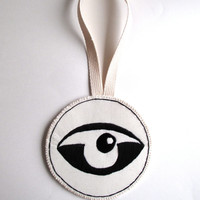 Textile wall hanging hand embroidered abstract eye on a round cream muslin long canvas loop