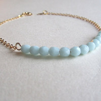 Turquoise & gold chain bracelet-Opaque Turquoise glass beads on a gold plated chain, Bracelet