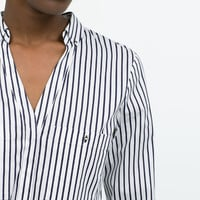 Striped low-cut shirt with gold buttons