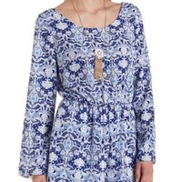 Long Sleeve Romper with Caged Back by Charlotte Russe - Blue Combo
