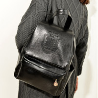 Leather Badge Backpack