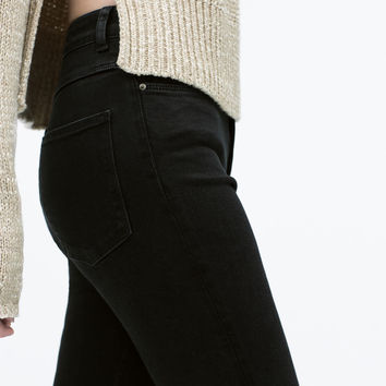 High-rise ripped skinny jeans