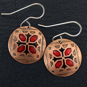 Red and black tile earrings in copper.