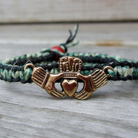 Brass tone Claddagh charm hemp bracelet.