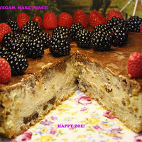 Vegan Super Creamy Vanilla dream cheesecake with natural raisins on the most delicious lemon chocolate chip sponge cake plus chocolate