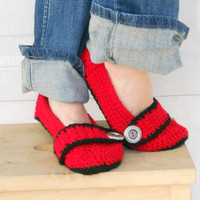 Cherry red crocheted slippers, booties, shoes, socks with a button strap.