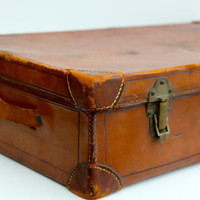 Antique luxury leather suitcase with a key