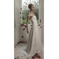 FLEUR A stunning tiered lace bridal gown with drop pearl detail