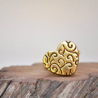 Gold heart ring. Unique design.