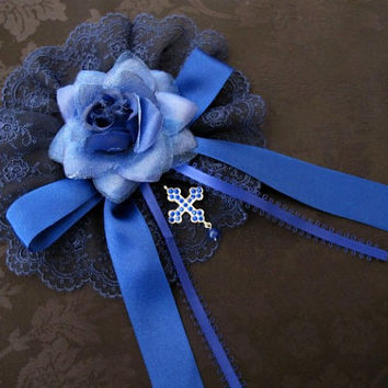 Blue embroidered tulle lace headdress with flower, satin ribbon and cross