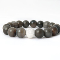 putty gray agate bracelet with autumn tones of taupe, concrete and driftwood. silver focal bead. stretch. yoga. titanium.