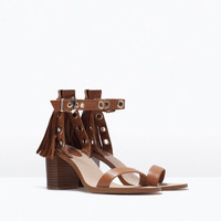 Fringed block heel leather sandals