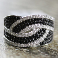 Interlocking Weave Infinity Knot Ring made with Black & White Cubic Zirconia and 925 Sterling Silver Micro Pave Interlocked wave CZ