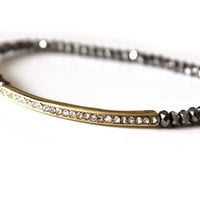 Elastic bracelet with silver crystals and gold bar with rain-stones