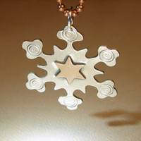 Sterling silver snowflake pendant handmade with a golden bronze star