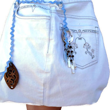 Cream upcycled jeans crossbody purse. Unique diaper bag decorated with a blue ribbon and plastic embellishments