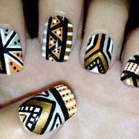 Orange and gold aztec/tribal fake nails