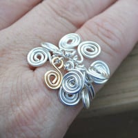 Adjustable Spiral Charmed Dangle Ring