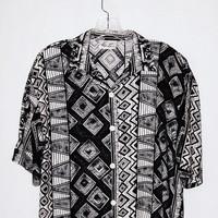 1990's abstract geometric print shirt / tribal pattern / women short sleeve blouse / black and cream / shoulder pads / art to wear