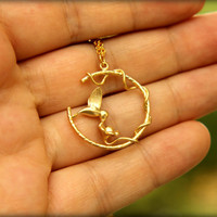 Feeding Hummingbird Necklace in Gold