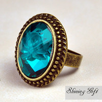 Blue Resin gemstone adjustable ring with a flower inside