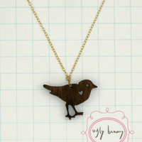 laser cut walnut bird necklace by uglybunnybysarahjane on Etsy