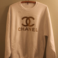 gold print chanel logo jumper