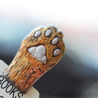 Cat paw. Orange paw in the book. Unusual bookmark. Funny gift. Cat in book for child, children, kids, for her, all, hostess. oht, theteam