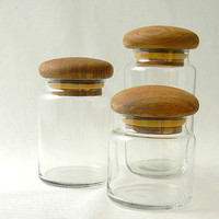 midcentury glass canisters with teak mushroom tops by FlumeStreet