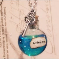 Iridescent Alice in Wonderland 'drink me' necklace - Glass vial, Blue resin, key charm on silver plated chain