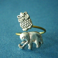 Silver owl ring with an elephant