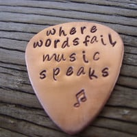 Guitar pick- hand stamped custom copper guitar pick- where words fail music speaks ready to ship